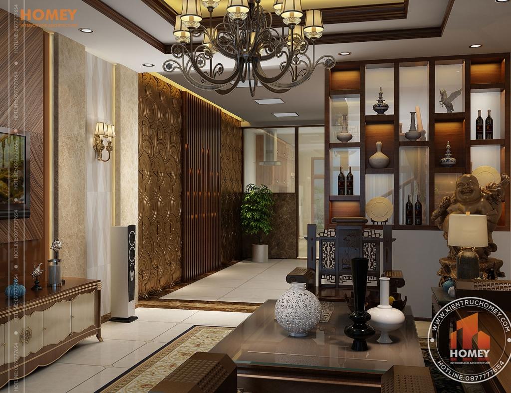 Phòng khách có vách trang trí cầu thang